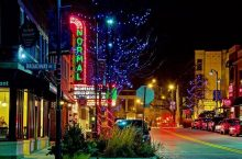 Uptown Normal brightly lit by Christmas lights and the Normal Theatre marquee
