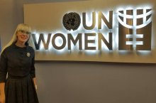 Criminal Justice Sciences Professor Shelly Clevenger in front of UN Women sign