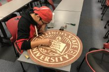 Andrew Wiercinski working on wooden seal