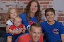 Ben Piper poses with his family in Cubs gear