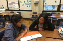 Alexa Leyba works with a student