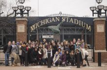 ISU students pose outside Michigan football stadium