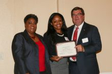 Senior Totiana Sudduth, with President Larry Dietz, receives a BCA scholarship during the 2016 BCA scholarship brunch.