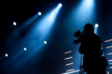 image of Cameraman silhouette on a concert stage