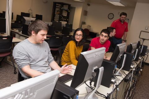 Students sitting in front of computers