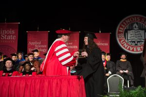 Emily Vigneri accepts the Civil Service Distinguished Service Award from President Larry Dietz at this year's Founders Day Convocation.