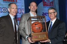 Dan Muller accepting the the trophy for MVC Coach of the Year with MVC officials