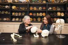 Anthropology Professor Maria Smith is working with students like Katharine Woollen to study remains unearthed from the Schroeder Mounds in order to answer questions about a mysterious pre-Columbian people. (Editor's note: The bones in this photograph are replica skeletal remains.)