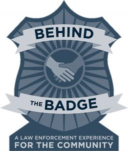 image of a badge with hands shaking.