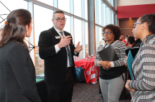 Employers share about their diversity initiatives with students at the Diversity Employer Expo.