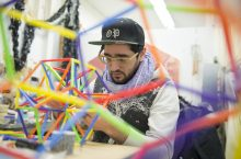 Student works on sculpture