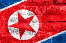 image of North Korean flag painted on a wall.