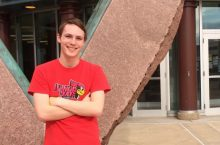 Sam Kempel poses outside Science Lab Building