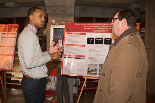 Graduate student Joel Lockhart talks to President Larry Dietz about the former's athletic training research.