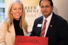 College of Business Dean Ajay Samnant, right, and Melissa Kats '11, 2016 Early Career Achievement Award winner.