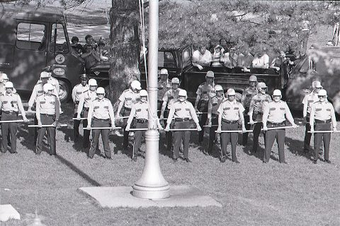 Illinois State Police guard the flagpole on Illinois State's Quad on May 19, 1970
