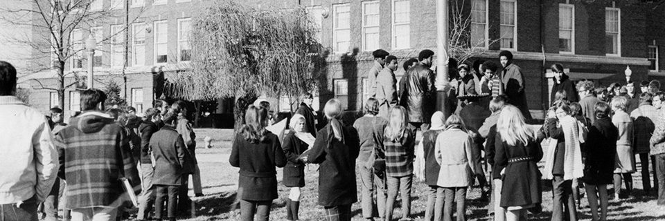 Members of the Black Student Association gathered around the flagpole on December 4, 1969