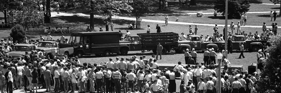University vehicles formed a barricade around the flagpole on May 19, 1970