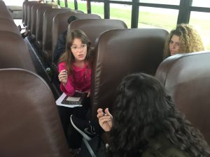 Redbirds talk on a bus