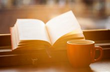 image of Books and a coffee cup on a windowsill