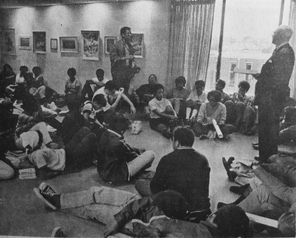 President Braden speaking with student protesters during a fall 1968 sit-in