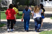 Women walk on the Quad