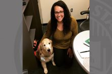 Olivia Butts with therapy dog, Cece