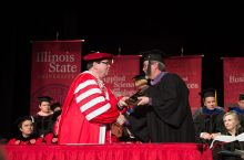 Kentzler accepting his award from Dr. Dietz