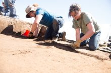 Illinois State anthropology students Brian Keeling and Molly McManus dig through the thick soil at the Noble-Wieting site.