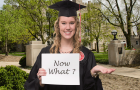 "New graduate holding a ""Now what?"" sign"