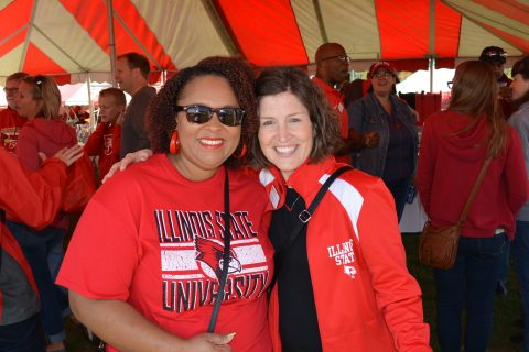 Angell Davis and Erin Thomas at the Student Affairs tent at Homecoming 2016.
