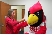 Regie Redbird gets a flu shot