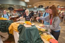 Students select their food at Local Foods dinner
