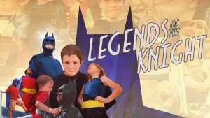 Batman and children in heroic poses