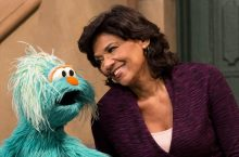 Sonia Manzano speaks with a Muppet.