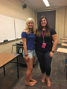 Two female students standing next to each other