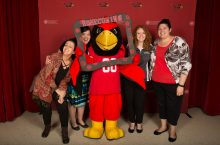 Faculty and staff pose with Reggie Redbird at the 2016 Faculty-Staff Appreciation Luncheon.