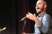 Slam poet Neil Hilborn performing at a mic