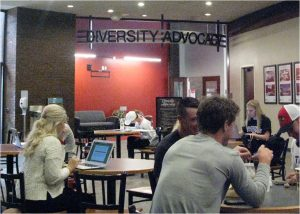 people working in the Bone Student Center in front of the Diversity Advocacy.