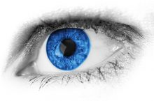 black and white photo of a blue eye