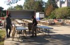 ISU Movers setting up tables and chairs for Homecoming