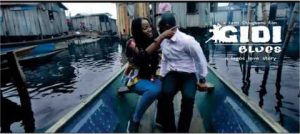 Man and a woman on a small boat, drifting through a neighborhood in Lagos.