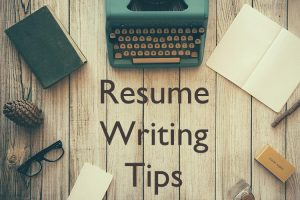 Image of a typewriter, pencil, glasses, and paper with the words Resume Writing Tips in the image