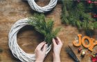 hands making a wreath with the words JOY spelled out in block letters