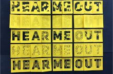 The phrase Hear Me Out repeated in different font styles as part of an exhibit at Milner Library.
