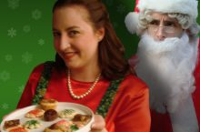 Woman with cookie and Santa Claus behind her.