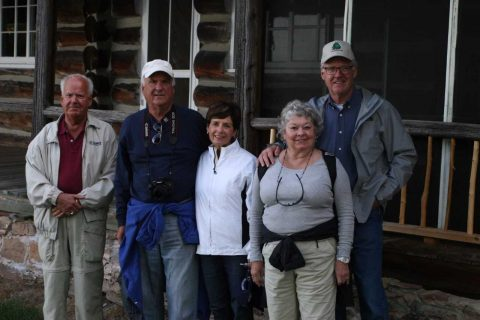 The Klauer family stands in front of the Mather-Klauer Lodge in Grand Island.