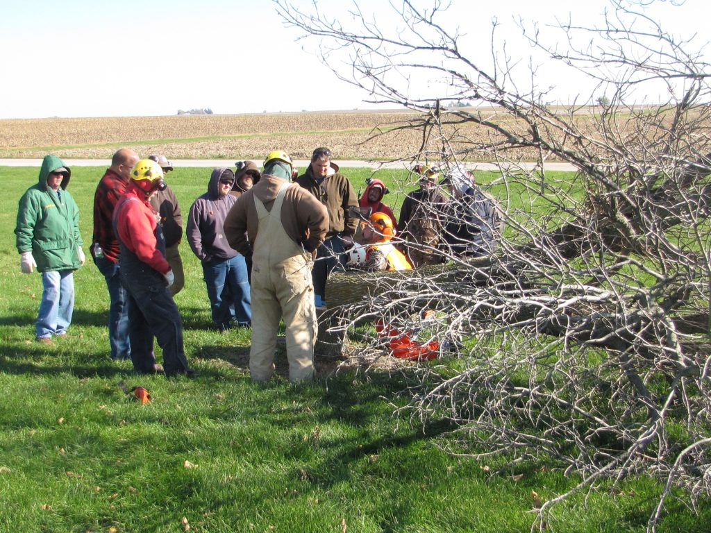isu grounds crew sharpening their chainsaws and tree removal skills