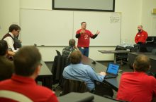 Photo of Dean Plumadore addressing a class of IT professionals.