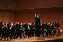 Photo of Anthony Marinello conducting the ISU Wind Ensemble on September 22, 2017